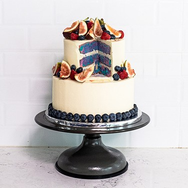 Tiered Cake with Multi-Colored Layers and Fresh Berries Recipe | SideChef